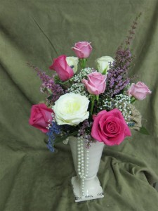 Fresh Flowers for Mother's Day featuring hot pink, pale pink, and ivory roses, with heather and baby's breath.
