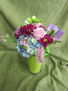 Fresh Flowers for Mother's Day featuring pink roses, pink daisies, purples tulips, and blue hydrangea