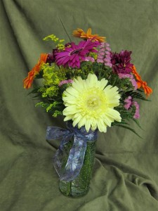 Fresh Flowers for Mother's Day featuring gerbera daisies, solidago, and status.